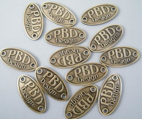 brass oval badge